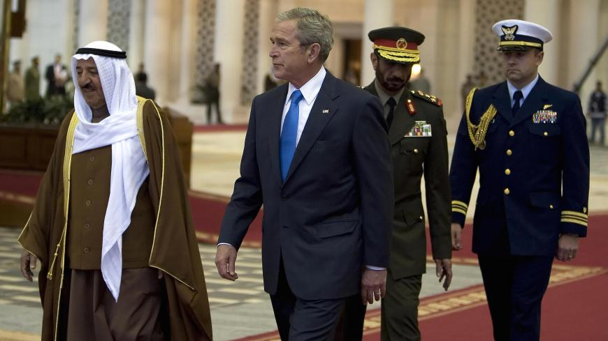 "US President George W. Bush (C) and Emir of Kuwait Sheikh Sabah al-Ahmad al-Sabah (L) walk together during the arrival ceremony of the former at Kuwait International Airport in Kuwait City, 11 January 2008. US President George W. Bush arrived in Kuwait today to rally the support of Arab allies against what he calls the Iranian ""threat,"" after making a bold prediction for Middle East peace. AFP PHOTO/JIM WATSON (Photo credit should read JIM WATSON/AFP via Getty Images)"