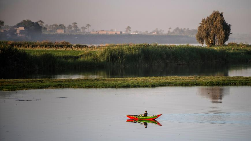 An Egyptian fisherman rows along the River Nile near Abou Shosha village in the Qina (Qena) governorate, some 600 kilometres south of the capital Cairo on March 21, 2018. / AFP PHOTO / KHALED DESOUKI        (Photo credit should read KHALED DESOUKI/AFP via Getty Images)