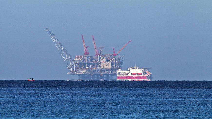 A view of the platform of the Leviathan natural gas field in the Mediterranean Sea is pictured from the Israeli northern coastal city of Caesarea on December 19, 2019. - Israel has approved the export of gas from its offshore reserves to Egypt, a spokeswoman said on December 17, with a major reservoir expected to begin operations imminently. The approval by Energy Minister Yuval Steinitz was part of a long process under which Israel will transform from an importer of natural gas from Egypt into an exporter