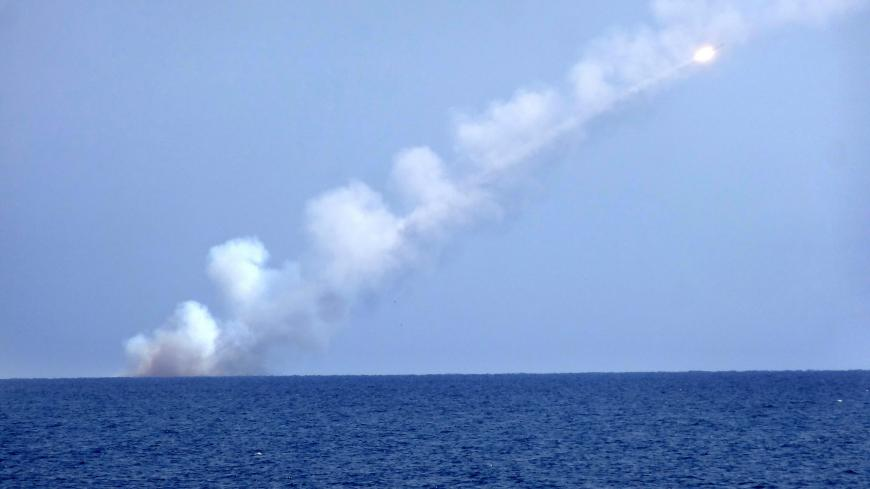 A picture shows a Russian cruise missile launching from a submarine at an undisclosed location in the Mediterranean Sea on September 14, 2017. - The Russian Defence Ministry launched cruise missiles from submarines in the Mediterranean aimed at Islamic State targets in eastern Syria. (Photo by Maria Antonova. / AFP) (Photo by MARIA ANTONOVA./AFP via Getty Images)