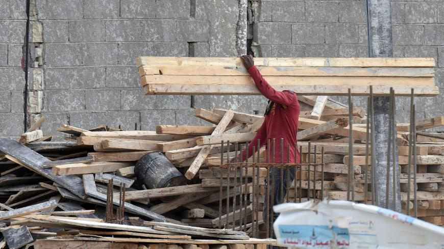 A foreign labourer works on the construction of a house in the Saudi capital Riyadh on April 13, 2019. - Housing is a potential lightning rod for public discontent in a country where affordable dwellings are beyond the reach of many, posing a key challenge for Crown Prince Mohammed bin Salman as he seeks to overhaul the oil-reliant economy. (Photo by FAYEZ NURELDINE / AFP)        (Photo credit should read FAYEZ NURELDINE/AFP via Getty Images)