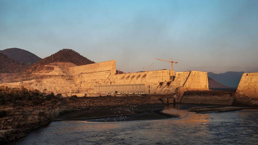 A general view of the the Grand Ethiopian Renaissance Dam (GERD), near Guba in Ethiopia, on December 26, 2019. - The Grand Ethiopian Renaissance Dam, a 145-metre-high, 1.8-kilometre-long concrete colossus is set to become the largest hydropower plant in Africa. Across Ethiopia, poor farmers and rich businessmen alike eagerly await the more than 6,000 megawatts of electricity officials say it will ultimately provide.  Yet as thousands of workers toil day and night to finish the project, Ethiopian negotiators