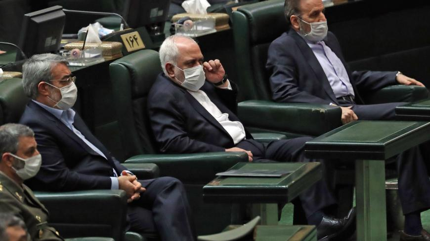 "Iranian Foreign Minister Mohmmad Javad Zarif (C) attends during the inaugural session of the new parliament in Tehran on May 27, 2020, following February elections. - The 11th legislature since the Islamic revolution of 1979 opened as the country's economy, which has been hard hit by the novel coronavirus, gradually returns to normal. Rouhani, who is in the final year of his second and final term, called on MPs, collectively and individually, to place the ""national interest above special interests"", ""party"