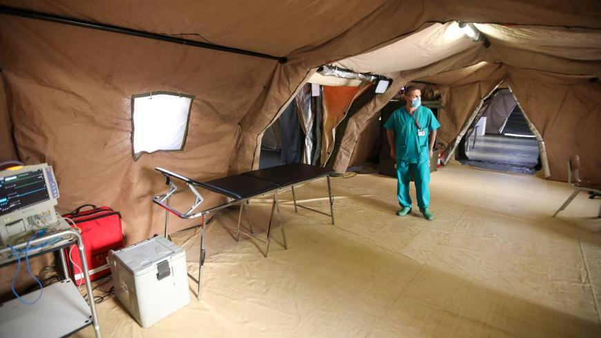 An Italian medic walks around in the coronavirus ward at the Italian field hospital in the Lebanese University campus in the town of Hadath, north of the capital Beirut on September 8, 2020. (Photo by ANWAR AMRO / AFP) (Photo by ANWAR AMRO/AFP via Getty Images)