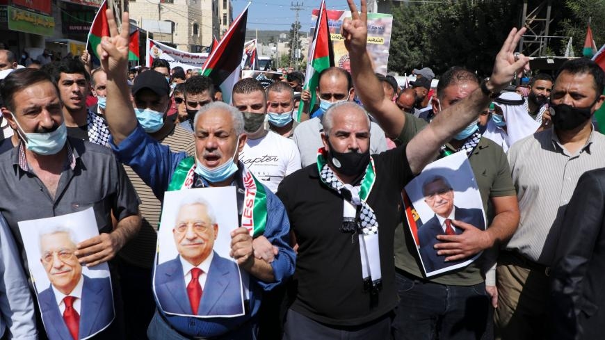 Palestinians carry the portrait of president Mahmud Abbas as they gather to commemorate the second intifada and to protest the Israeli normalisation deals with the United Arab Emirates and Bahrain, in the town of Tubas, in the occupied West Bank on September 27, 2020. - The second intifada lasted five years, during which attacks were carried out in Israel, the Gaza Strip and the West Bank. In response Israel reoccupied much of the West Bank and began building a separation barrier between the two communities