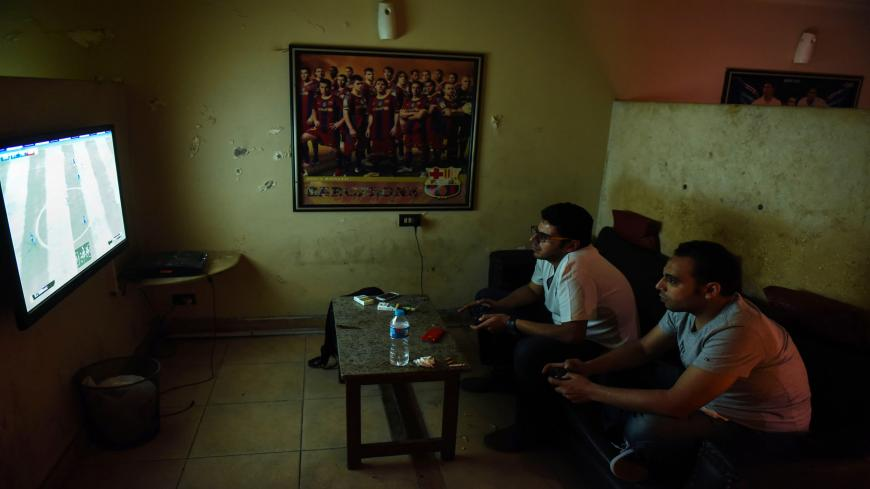 Unemployed Egyptian men play a video game at a cafe in the capital Cairo on October 8, 2015. North Africa and Middle East regions still have the highest unemployment rate in the world, according to a World Trade Organization (WTO) report published on October 8, 2015. AFP PHOTO  / MOHAMED EL-SHAHED        (Photo credit should read MOHAMED EL-SHAHED/AFP via Getty Images)