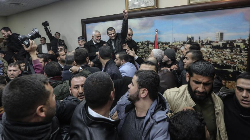 Members of the Palestinian Islamist Hamas movement is greeted by supporters before at the movement's leader Ismail Haniyeh's office in the Gaza Strip on February 28, 2019. - The Hamas leader announced in a press release today the release of four detainees from his group held in Egypt since August 2015. (Photo by MAHMUD HAMS / AFP)        (Photo credit should read MAHMUD HAMS/AFP via Getty Images)