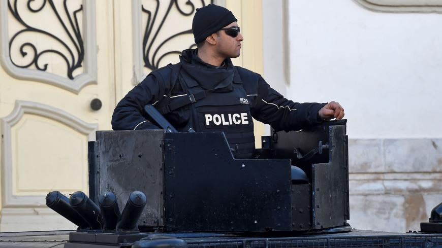A Tunisian policeman stands guard in central Tunis during a rally marking the ninth anniversary of the 2011 uprising on Habib Bourguiba Avenue on January 14, 2020. (Photo by FETHI BELAID / AFP) (Photo by FETHI BELAID/AFP via Getty Images)