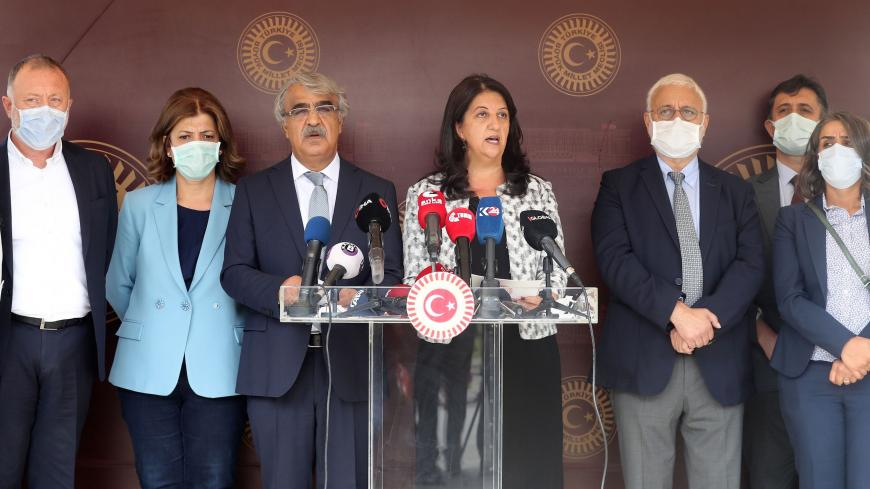 Co-chairmans of the pro-Kurdish Peoples' Democratic Party (HDP) Pervin Buldan (C-R) and Mithat Sancar (C-L) hold a press conference with their parliament members as they boycott the first sessiom of the Grand National Assembly's 27th term following the arrest of 82 people, including members of their party, outside the Parliament building in Ankara on October 1, 2020. - Turkish prosecutors on October 1 issued arrest warrants for 82 people, including a mayor and several former lawmakers from the pro-Kurdish H