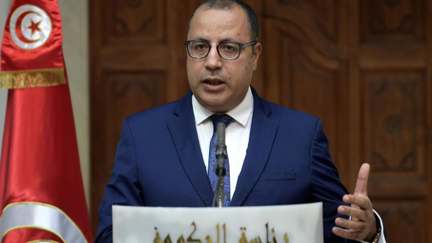 Tunisian Prime Minister Hichem Mechichi gives a press conference on November 3, 2020 in Tunis, after his meeting with several economic experts. (Photo by FETHI BELAID / AFP) (Photo by FETHI BELAID/AFP via Getty Images)