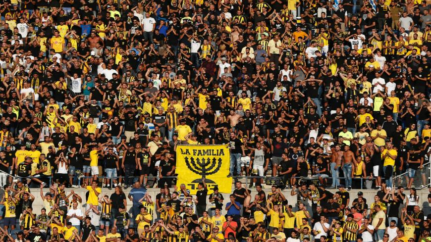 Beitar Jerusalem fans cheer on their team prior to the UEFA Europa League play-off football match between Beitar Jerusalem and AS Saint-Etienne, at the Itztadion Teddy Stadium in Jerusalem on August 17, 2016.  Saint-Etienne beat Beitar Jerusalem 2-1. / AFP / AHMAD GHARABLI        (Photo credit should read AHMAD GHARABLI/AFP via Getty Images)