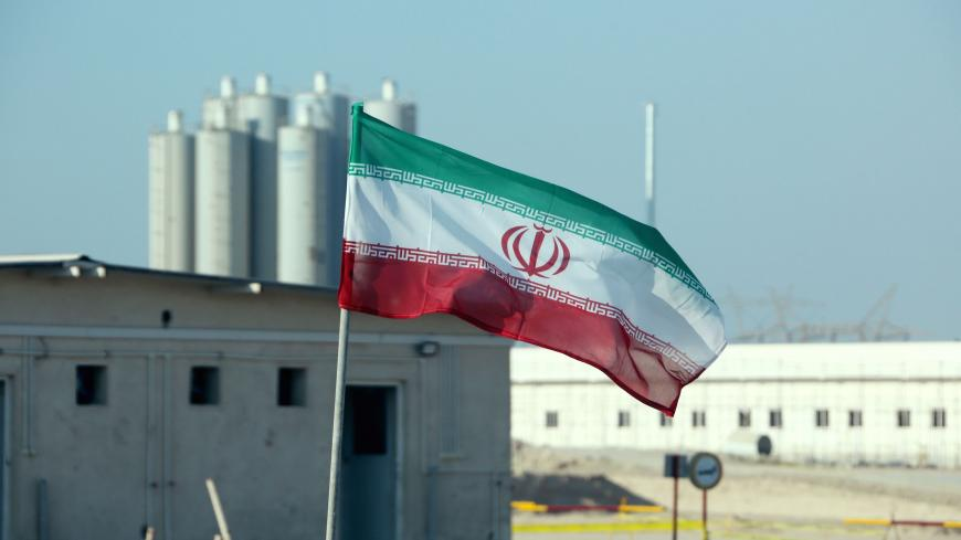 A picture taken on November 10, 2019, shows an Iranian flag in Iran's Bushehr nuclear power plant, during an official ceremony to kick-start works on a second reactor at the facility. - Bushehr is Iran's only nuclear power station and is currently running on imported fuel from Russia that is closely monitored by the UN's International Atomic Energy Agency. (Photo by ATTA KENARE / AFP) (Photo by ATTA KENARE/AFP via Getty Images)