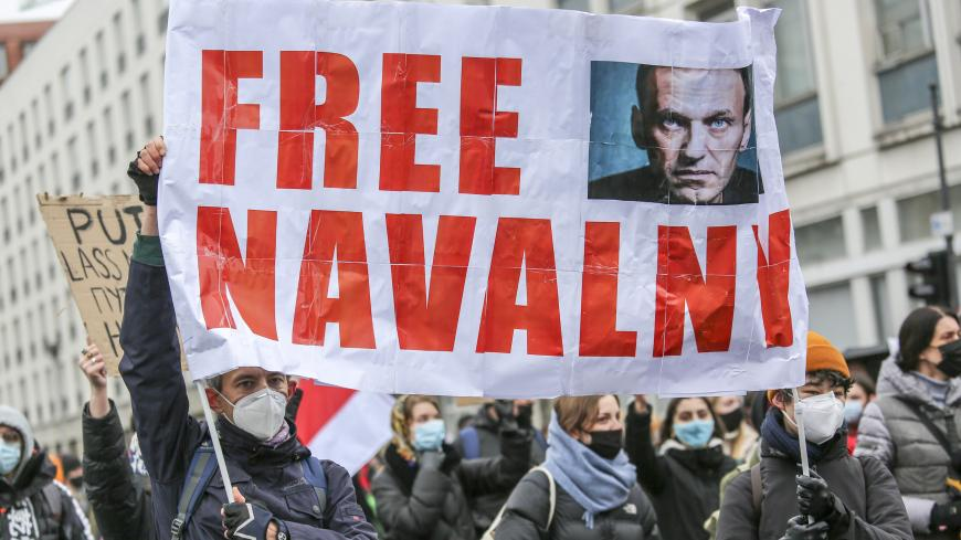BERLIN, GERMANY - JANUARY 23: Some 2500 supporters of Russian opposition politician Alexei Navalny  marched in protest demand for his release from prison in Moscow on January 23, 2021 in Berlin, Germany. The protesters marched from the federal chancellery through the Russian embassy to Brandenburg Gate in part also heeding a call by Navalny to protest against Russian President Vladimir Putin. Navalny, who was arrested earlier this week upon his return to Moscow from Germany, has called for protests against