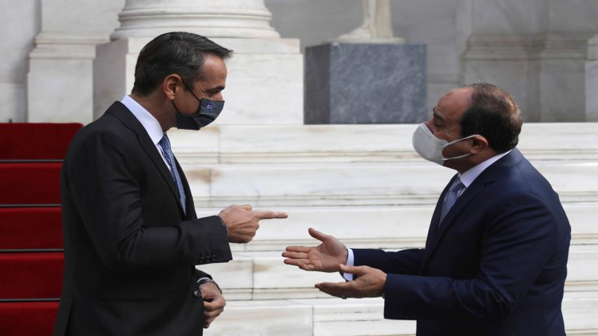 Greek Prime Minister Kyriakos Mitsotakis (L) welcomes Egyptian President Abdel Fattah el-Sisi at the Maximos Mansion in Athens, on November 11, 2020. - Greek Prime Minister and Egyptian President discussed the tensions in the eastern Mediterranean where Turkey and Greece Turkey and Greece are arguing over the boundaries of maritime zones. (Photo by Yorgos KARAHALIS / POOL / AFP) (Photo by YORGOS KARAHALIS/POOL/AFP via Getty Images)
