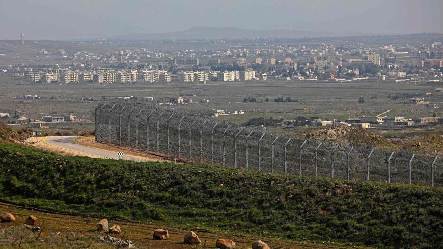 This picture taken from the Israeli-annexed Golan Heights on February 4, 2021, shows the border fence with the Syrian governorate of Quneitra. (Photo by JALAA MAREY / AFP) (Photo by JALAA MAREY/AFP via Getty Images)