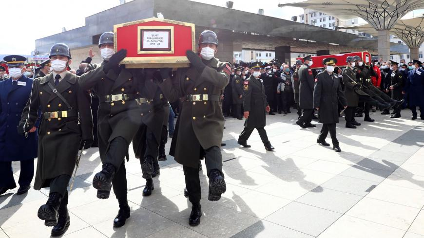 The coffins of three Turkish military personnel killed in action are carried during funeral prays at the Ahmet Hamdi Akseki Mosque in Ankara on February 12, 2021. - The three soldiers Lt. Burak Coskun, Lt. Ertug Guler and Sgt. First Class Harun Turhan were killed during clashes with Kurdish militants in northern Iraq's Gara region as part of the Eagle Claw 2 operation by the Turkish military against the outlawed Kurdistan Workers' Party (PKK). (Photo by Adem ALTAN / AFP) (Photo by ADEM ALTAN/AFP via Getty I
