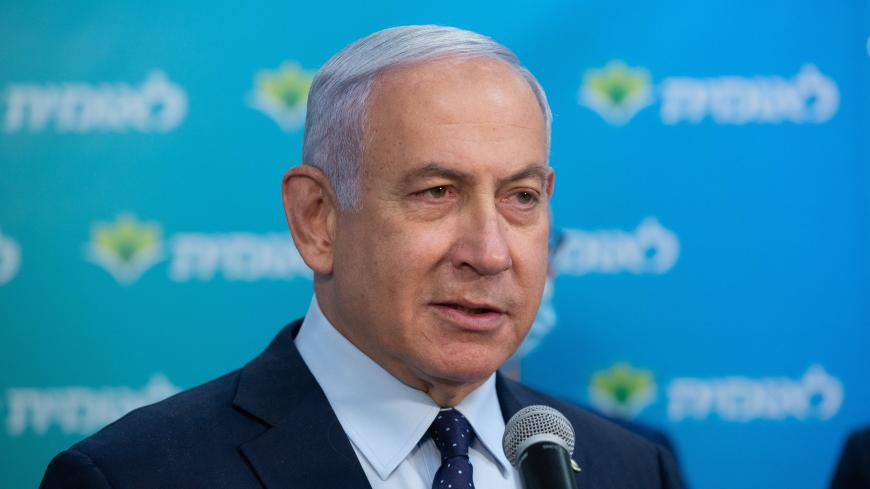 Israeli Prime Minister Netanyahu attends a ceremony marking the 4,000,000th person to be vaccinated at Leumit Health Care Services vaccination facility in Jerusalem on February 16, 2021. - Israel's largest healthcare provider said a study of more than half a million fully vaccinated Israelis indicated the Pfizer/BioNTech jab gave 94 percent protection against Covid-19. (Photo by Alex KOLOMIENSKY / POOL / AFP) (Photo by ALEX KOLOMIENSKY/POOL/AFP via Getty Images)