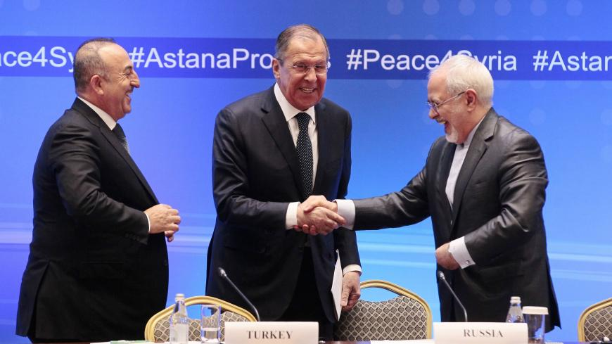Russian Foreign Minister Sergei Lavrov (C) shakes hands with Iranian Foreign Minister Mohammad Javad Zarif (R) and Turkish Foreign Minister Mevlut Cavusoglu following their talks on Syria in Astana on March 16, 2018. / AFP PHOTO / Alexey FILIPPOV        (Photo credit should read ALEXEY FILIPPOV/AFP via Getty Images)