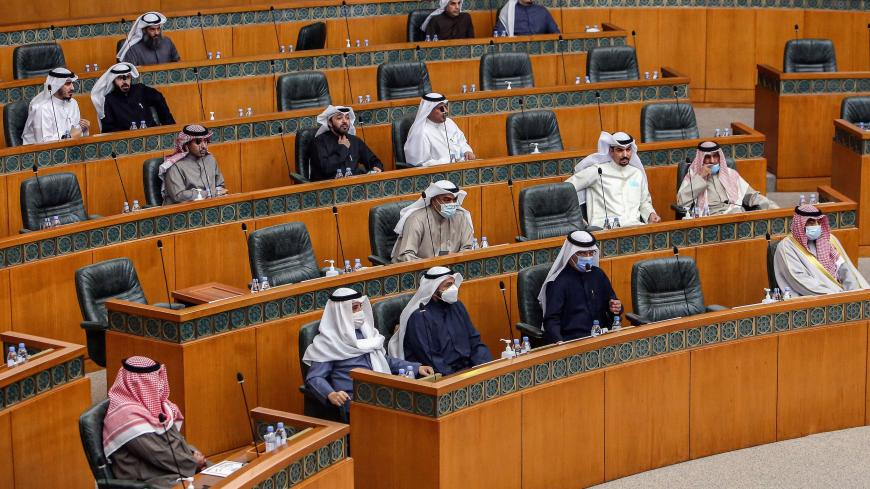 Kuwaiti members of parliament attend a special session following-up on measures undertaken by the government of limit the spread of COVID-19 coronavirus disease, at the National Assembly headquarters in Kuwait City on February 16, 2021. (Photo by YASSER AL-ZAYYAT / AFP) (Photo by YASSER AL-ZAYYAT/AFP via Getty Images)
