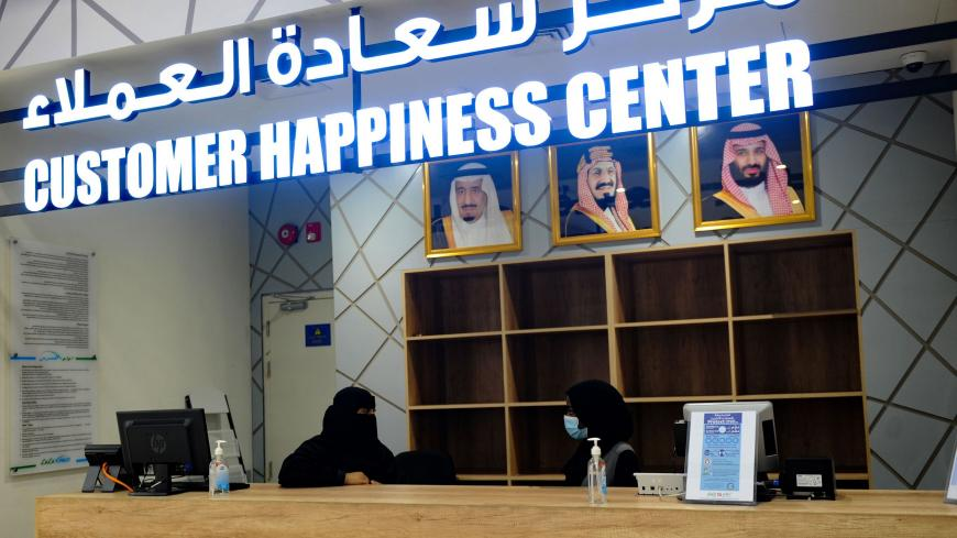 Saudi female employees work at the customers service desk at a hypermarket, newly launched by the operator LuLu and run by a team of women, in the Saudi Arabian port city of Jeddah, on February 21, 2021. (Photo by Amer HILABI / AFP) (Photo by AMER HILABI/AFP via Getty Images)