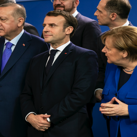 German Chancellor Angela Merkel (R), French President Emmanuel Macron (C) and Turkish President Recep Tayyip Erdogan (L) and other leaders pose for a family picture at the Chancellery on January 19, 2020, in Berlin, Germany.