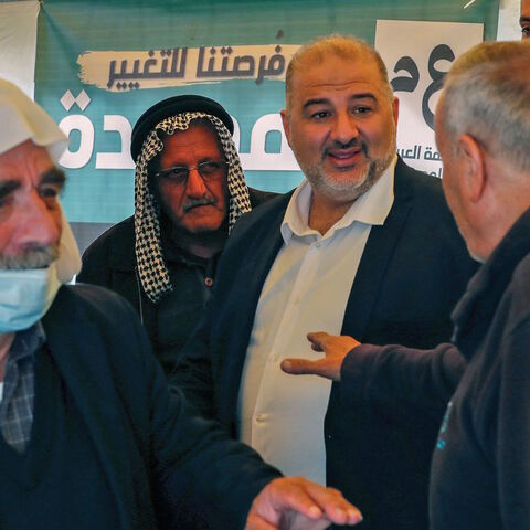 Mansour Abbas (C), head of Israel's conservative Islamic Raam party, speaks to supporters during a political gathering to congratulate him on the electoral victory in the northern Israeli village of Maghar on March 26, 2021.
