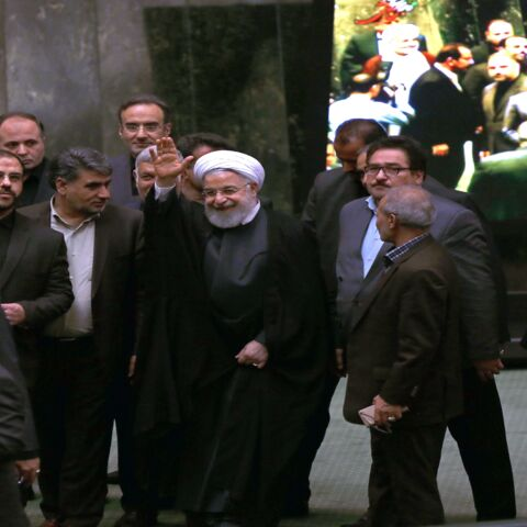"Iran's President Hassan Rouhani (C) arrives to address parliament in the capital, Tehran, on Sept. 3, 2019. In the address, he ruled out holding any bilateral talks with the United States, saying the Islamic Republic is opposed to such negotiations in principle. He also said Iran was ready to further reduce its commitments to a landmark 2015 nuclear deal ""in the coming days"" if current negotiations yield no results by Sept. 5."