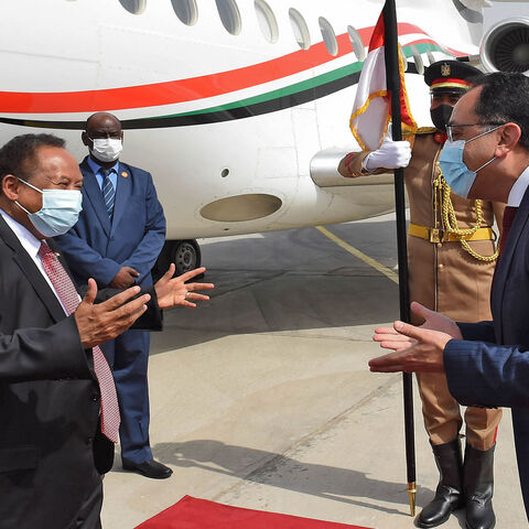 Egyptian Prime Minister Mustafa Madbouly (R) welcomes his Sudanese counterpart Abdalla Hamdok upon his arrival in Cairo, Egypt, March 11, 2021.