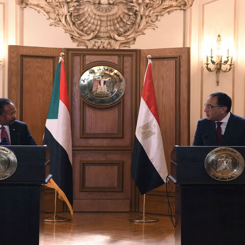 Egyptian Prime Minister Mustafa Madbouly (R) and his Sudanese counterpart Abdalla Hamdok give a joint press conference after meeting in Cairo, Egypt, March 11, 2021.