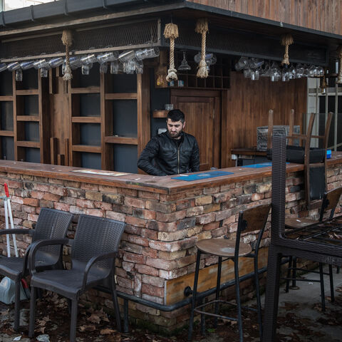 An employee of Dilo bar starts cleaning the rooftop terrace bar, which has been closed for 340 days due to coronavirus restrictions, in the Kadikoy district on Feb. 22, 2021 in Istanbul, Turkey.