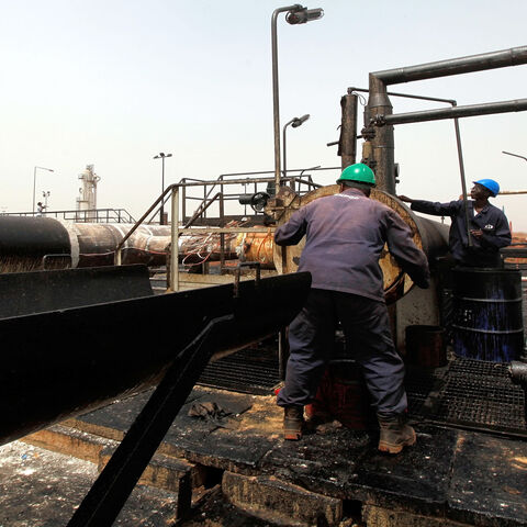 Sudanese repair crew work at the Heglig oil facility, after Sudan started pumping oil again from the war-damaged oil field on May 2, 2012, 12 days after occupying South Sudanese troops left the area.