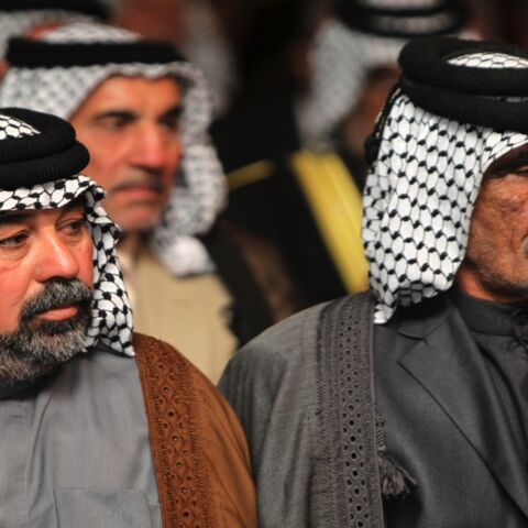 Iraqis attend a conference gathering Shiite and Sunni tribal leaders and clerics on November 8, 2014, in the capital, Baghdad, to discuss support to Sunni tribes in their fight against the Islamist State (IS) in Anbar province, west of Baghdad.