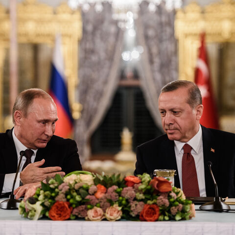 Russian President Vladimir Putin (L) speaks to Turkish President Recep Tayyip Erdogan (R) as they attend a press conference on Oct. 10, 2016, in Istanbul. Putin visited Turkey for talks pushing forward ambitious joint energy projects as the two sides try to overcome a crisis in ties.