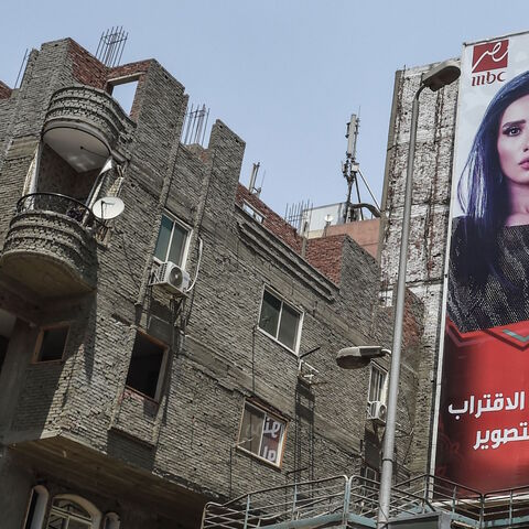 Billboards for TV Ramadan series are seen in the streets of the Egyptian capital Cairo on May 15, 2018. - Soaps and dramas normally united binge-watching Arab audiences during Ramadan but this year an Egyptian series has been caught up in a bitter dispute with Saudi Arabia over one of its star actors.