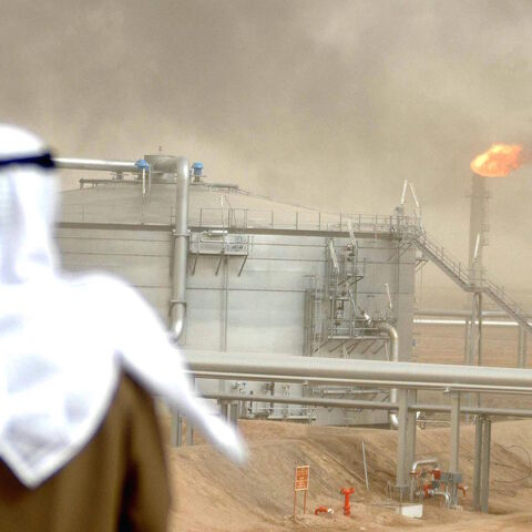 An employee of the Kuwait Oil Company (KOC) looks at 25 January 2005 the Gathering Center No.15 of al-Rawdatain field, 100 kms north of Kuwait City, following its inauguration just three years after coming under explosion.