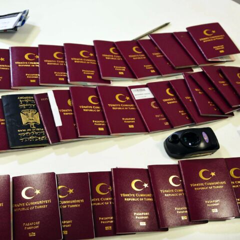 Fake passports and travel documents are displayed on a table for the press on Dec. 19, 2019, at the Istanbul airport in Turkey.