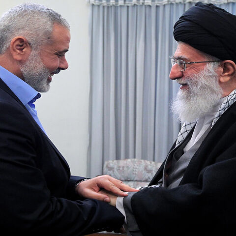 A handout photo made available by the office of Iran's supreme leader shows Iranian Supreme Leader Ayatollah Ali Khamenei greeting Ismail Haniya (L), Palestinian Hamas premier in the Gaza Strip, during a meeting in Tehran, Feb. 12, 2012.