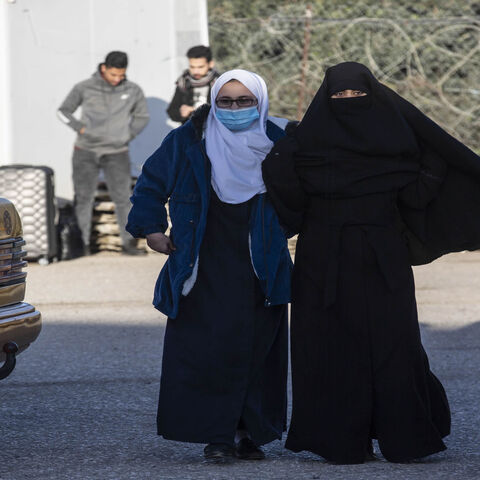 Palestinian women wait to leave the Rafah border crossing after it was opened by Egyptian authorities, in the southern Gaza Strip, Feb. 17, 2021.
