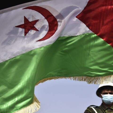 A Sahrawi soldier waves the Sahrawi flag during a parade marking the 45th anniversary of the declaration of the Sahrawi Arab Democratic Republic (SADR), at a refugee camp on the outskirts of the southwestern Algerian city of Tindouf, on Feb. 27, 2021.