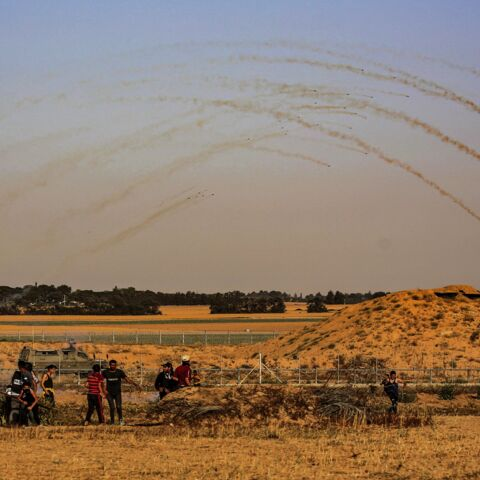 Israeli security forces fire tear gas at Palestinian protesters along the Israel-Gaza border, east of Khan Yunis town in the southern Gaza Strip on May 8, 2021. Israel braced for more protests after clashes at Jerusalem's flashpoint Al-Aqsa Mosque compound wounded more than 200 people and as the international community urged calm after days of escalating violence. The clashes came as tensions have soared over Israeli restrictions on access to parts of the Old City during Ramadan and the threat of eviction h