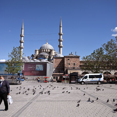 A man walks across the deserted Eminonu Square in Istanbul on May 9, 2021, during a new lockdown aimed at fighting a surging third wave of COVID-19 infections.