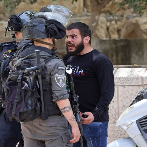 A Palestinian protester argues with Israeli security forces in the Old City of Jerusalem, as a planned march marking Israel's 1967 takeover of the holy city threatened to further inflame tensions, May 10, 2021.
