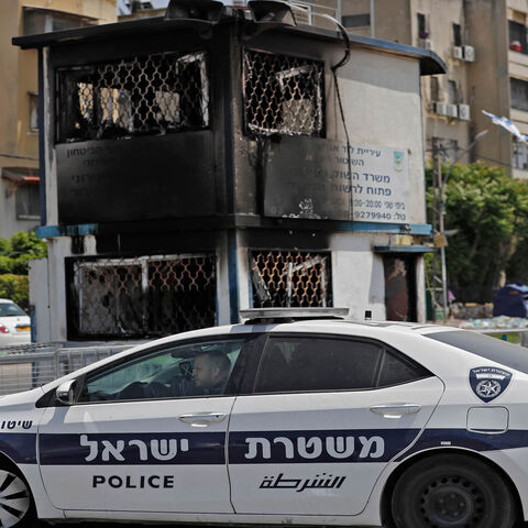 A torched observation post is seen outside a religious Jewish school in the central city of Lod, near Tel Aviv, following nighttime clashes between Arab Israelis and Israeli Jews, Israel, May 11, 2021.