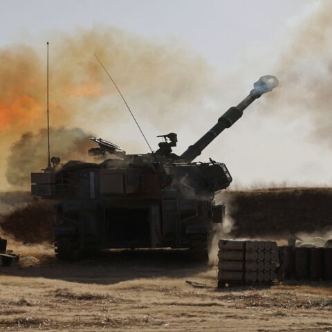 "Israeli soldiers fire a 155 mm self-propelled Howitzer toward targets in the Gaza Strip from their position near the southern Israeli city of Sderot on May 12, 2021. Israel's Defense Minister Benny Gantz vowed more attacks on Hamas and other Palestinian militant groups in Gaza to bring ""total, long-term quiet"" before considering a cease-fire."