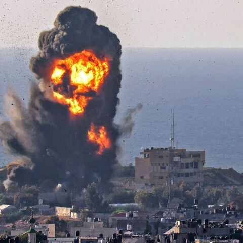 Smoke billows from an explosion following an Israeli air strike in Rafah in the southern Gaza Strip on May 13, 2021.