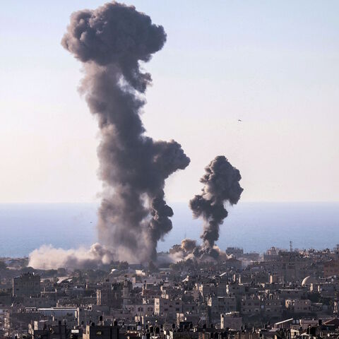 Smoke billows following an Israeli air strike in Rafah in the southern Gaza Strip on May 13, 2021.