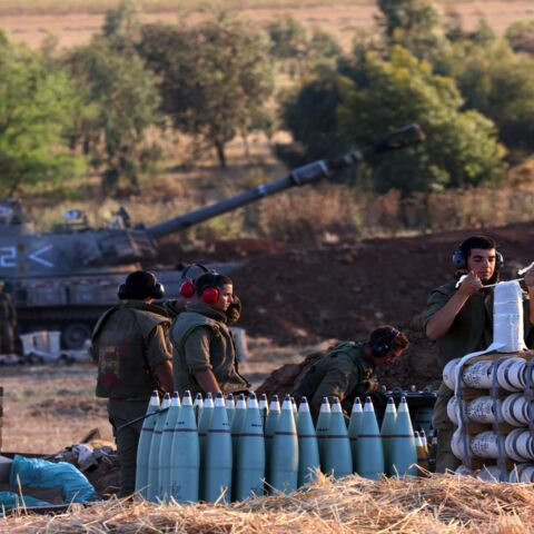 Israeli soldiers prepare a 155 mm self-propelled shell to fire toward the Gaza Strip from their position near the southern Israeli city of Sderot on May 13, 2021. Israel deployed additional troops to Gaza's border as the military conflict with Palestinian Islamists raged on, while inside Israel security forces scrambled to contain deadly riots between Jews and Arabs.