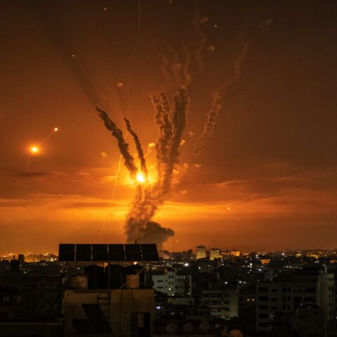 Rockets launched toward Israel from the northern Gaza Strip and response from the Israeli missile defense system known as the Iron Dome leave streaks through the sky on May 14, 2021, in Gaza City, Gaza.