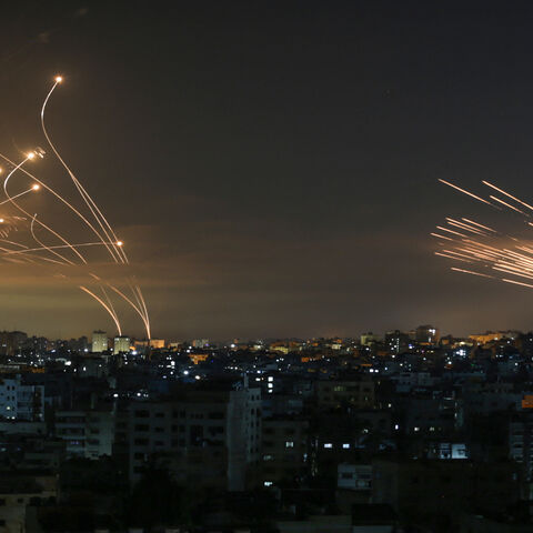 Rockets are seen in the night sky fired toward Israel from Beit Lahia, northern Gaza Strip, May 14, 2021.