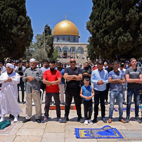 Palestinian Muslim worshippers pray at Jerusalem's al-Aqsa mosque compound, the third holiest site of Islam, on May 14, 2021.